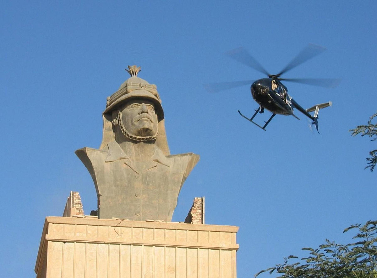 A Blackwater Little Bird Helicopter flies over the Republican Palace in Baghdad, December 2007. Photo: jamesdale10 (CC 2.0)
