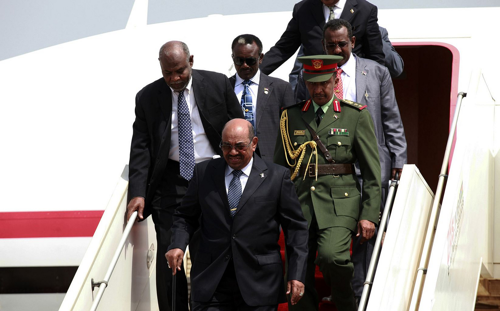 President Omar Hassan al-Bashir leaving plane in April, 2013. Photo: Abayomi Azikiwe (published under fair use policy for intellectual non-commercial purposes)