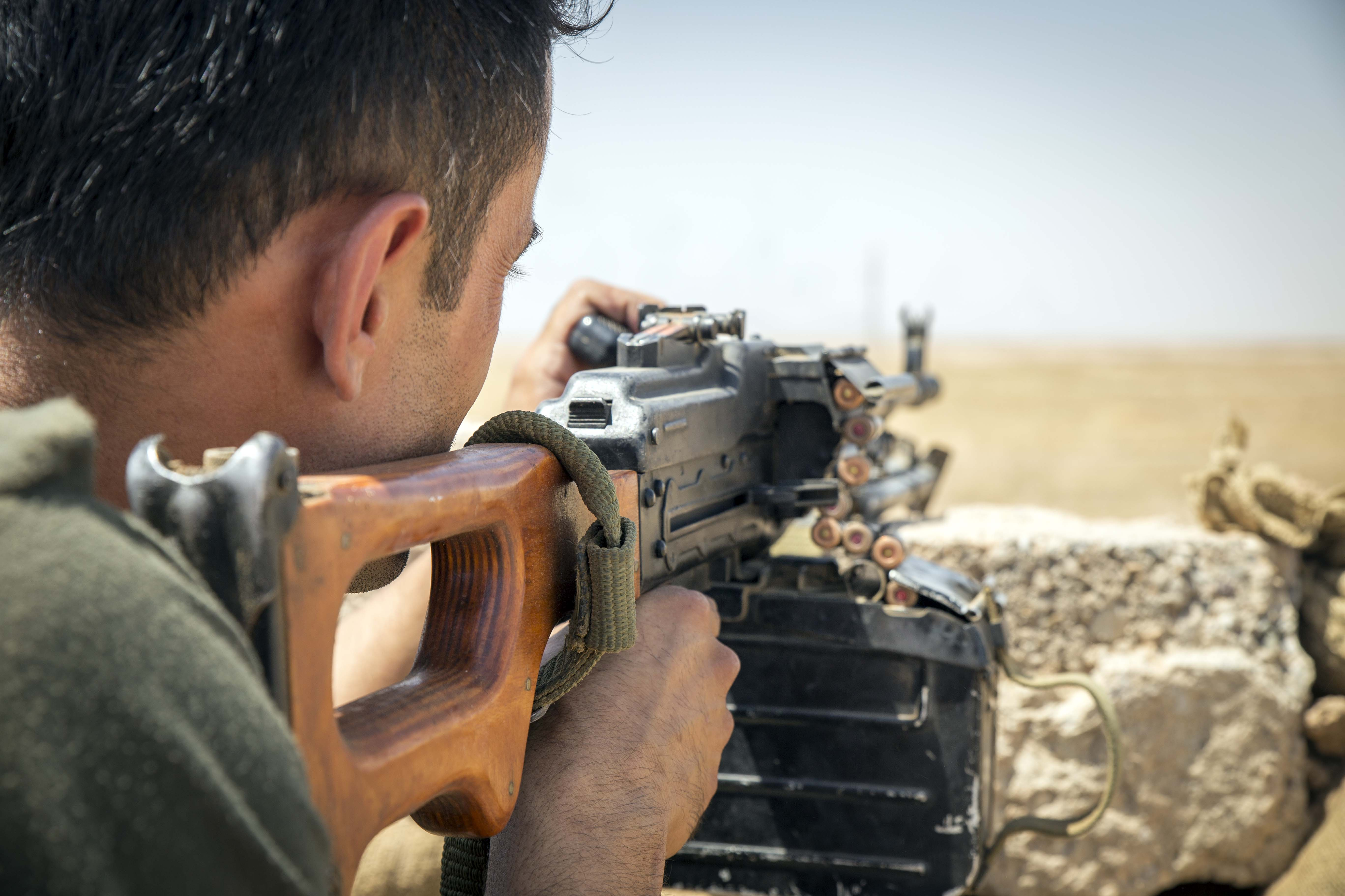 A fighter in position with his Russian made PK machine gun at the frontline south of Kirkuk.