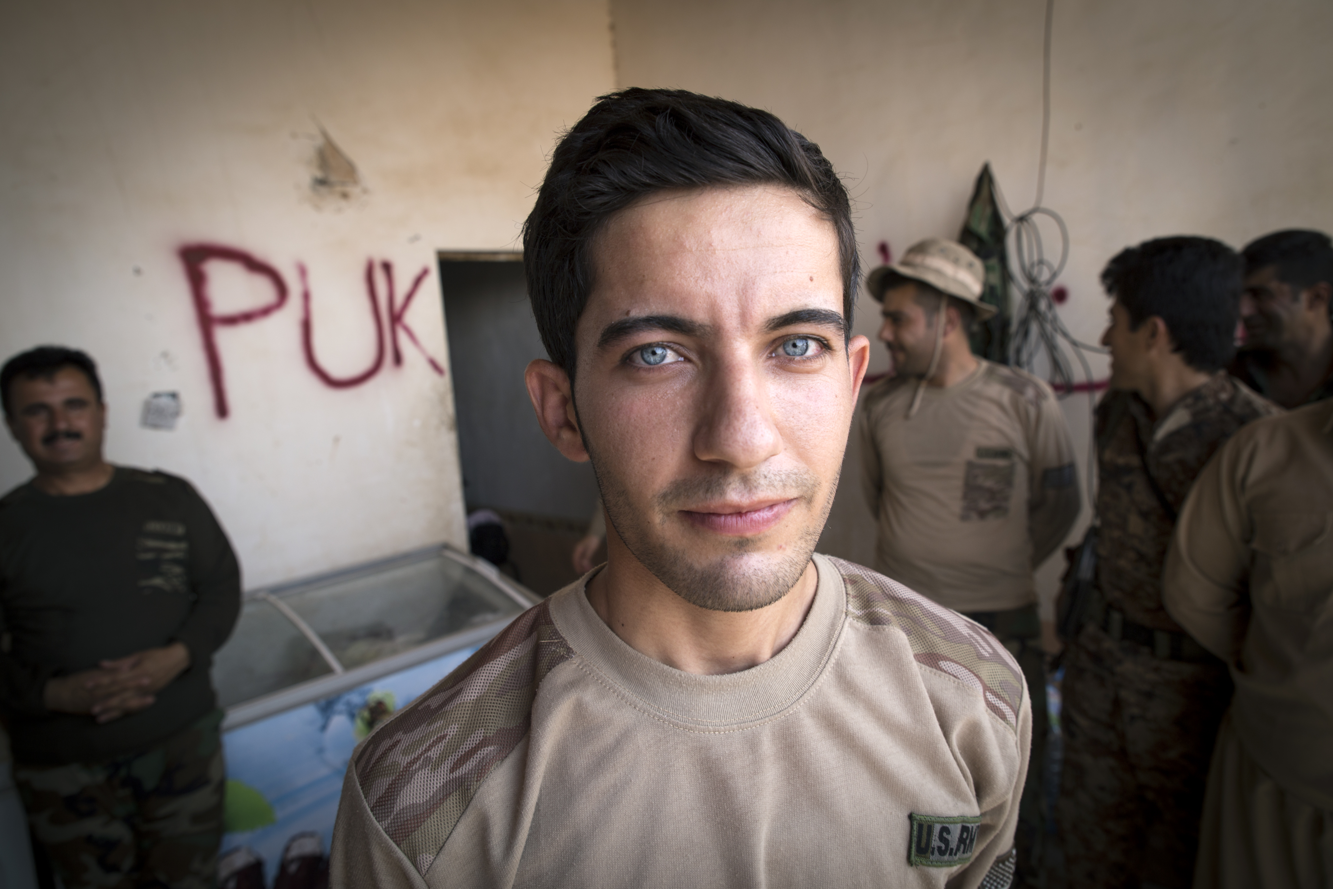 Peshmerga fighter Chewan, 22, bought his 'US Army' outfit in the local bazar in Koya. Most fighters have to pay for their own outfits.