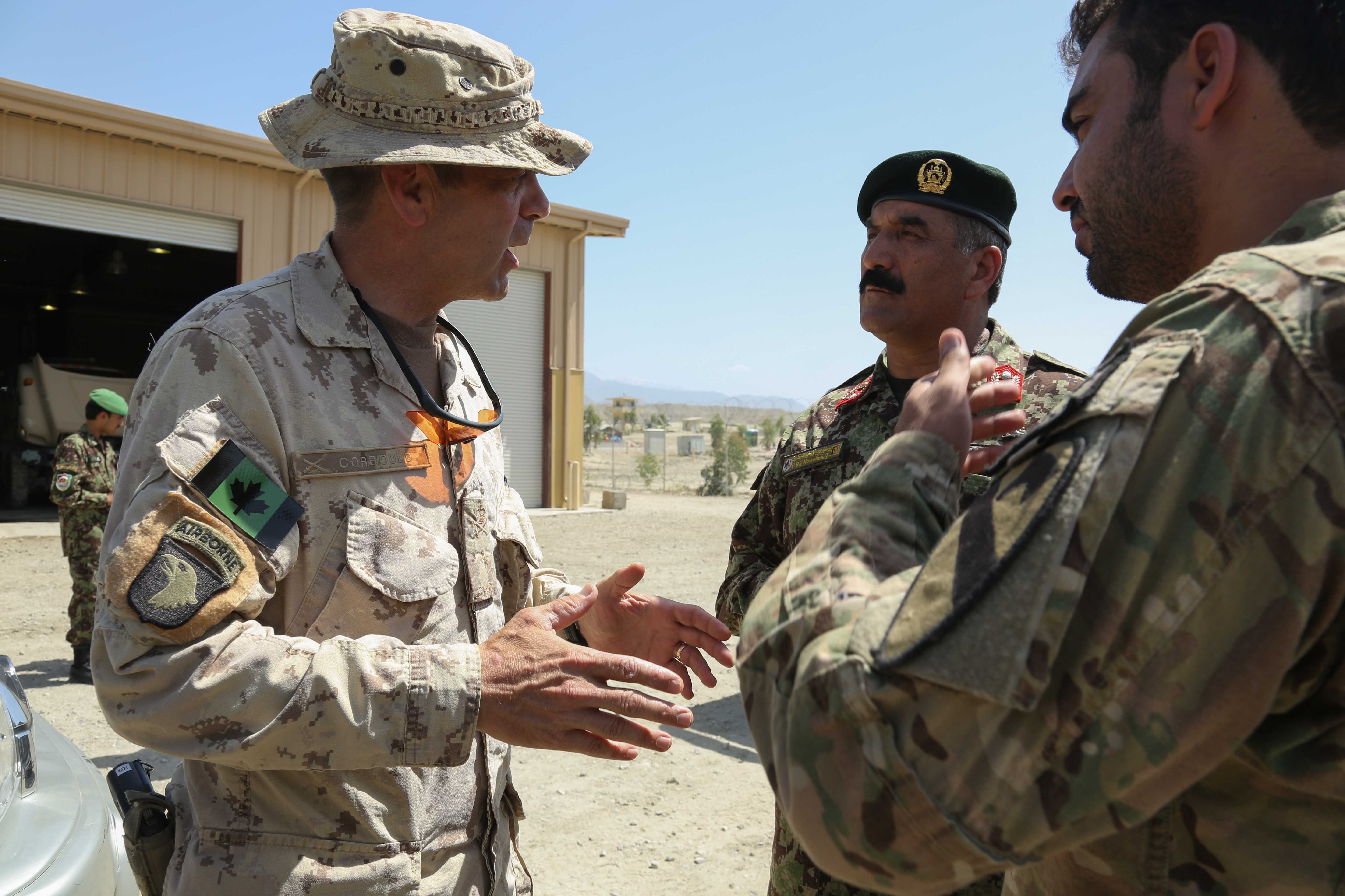 https://upload.wikimedia.org/wikipedia/commons/3/35/Canadian_Army_Brig._Gen._Dave_Corbould,_center_left,_the_deputy_commanding_general_of_Coalition_Effects_and_Transitions,_Combined_Joint_Task_Force_101,_Regional_Command_East,_talks_with_an_Afghan_National_Army_130523-A-XM609-063.jpg