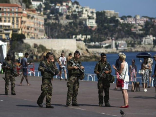 Soldiers patrols on the Promenade des Anglais in Nice, southern France, Wednesday, July 20, 2016. Joggers, cyclists and sun-seekers are back on Nice's famed Riviera coast, a further sign of normal life returning on the Promenade des Anglais where dozens were killed in last week's Bastille Day truck attack. Photo by Dan Kitwood/Getty Images