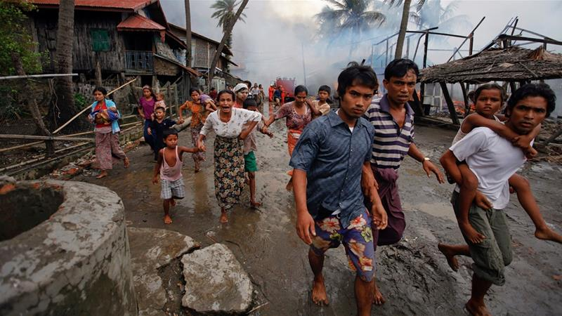 Rohingya fleeing from burned villages in the Maungdaw District of Myanmar.