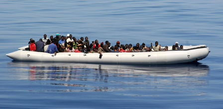 An inflatable hard bottom craft carrying some 87 would be immigrant maily from Somalia is pictured 26 miles from Lampedusa on June 15, 2008. AFP PHOTO/MAURICIO ESSE (Noborder CC 2.0)