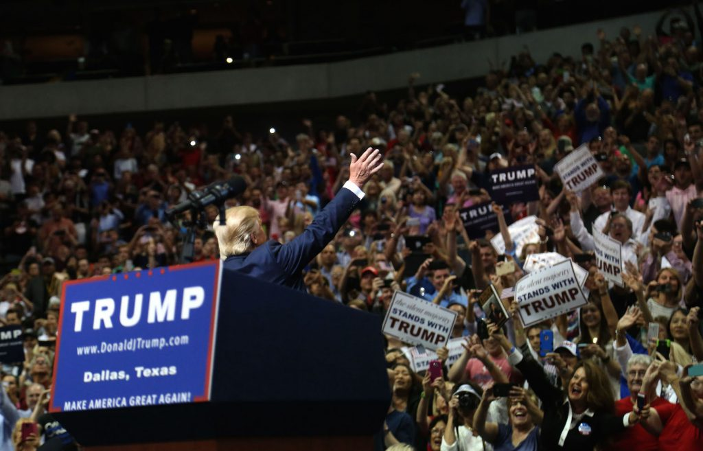 Donald Trump greets the crowd before speaking at a rally in Dallas, TX.
