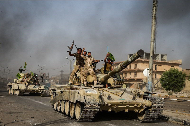 Iraqi armed forces retake the town of Fallujah from ISIS.